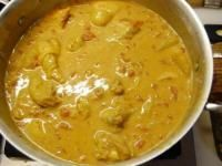 (Kenyan chicken in coconut curry sauce) This simple dish, sometimes called kuku na nazi, is a fabulous coconut curry from the East African coast. It is a perfect illustration of how African, Arab a...