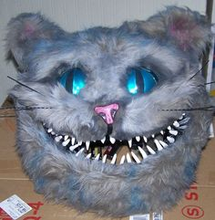 Chesire Cat costume crafted at home. The head was made of upholstery foam and plasic mesh to form the shape and covered in fur fabric then a...
