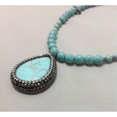 Turquoise Necklace with Turquoise Pendant Studded with Crystal Stones... ($42) ❤ liked on Polyvore featuring jewelry, necklaces, handcrafted necklaces, crystal jewelry, green turquoise necklace, crystal stone necklace and turquoise pendant