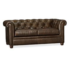 Chesterfield Leather Love Seat - with some oversized pillows and a comfy throw.