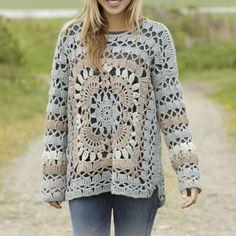 Un maglione a uncinetto con granny gigante: uno schema con spiegazioni in italiano. Dalla taglia S alla taglia XXXL con anche i video tutorial.