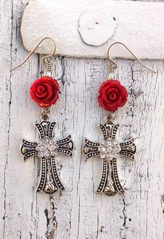 These crystal cross earrings have a beautiful red rose and they are in an antique silver finish. These religious christian cross earrings are