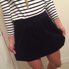 Navy Corduroy J. Crew Skirt This classic high waisted skirt is so flattering with a shirt tucked into it. Pair with a blouse for work or with a cotton tee and boots for the weekends. Great condition. J. Crew Skirts