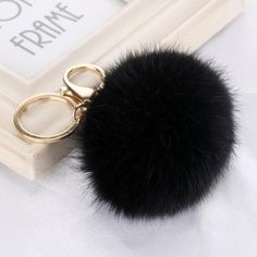 2016 Faux Rabbit Fluffy Ball Keychain. Click Picture to Purchase. https://liftingtheworld.com/collections/fluffy-balls-keychains