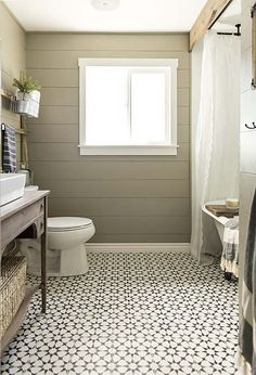 a pattern called Agadir, after the Moroccan city, from the Cement Tile Shop. Because the proportion of white is higher than the black, the floor has a lightweight appearance and simply looks contemporary rather than exotic.