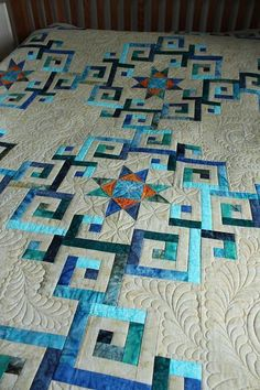"""Kathy was able to """"play"""" in the open spaces of this customer's batik quilt. Great flowing feathers – it's a lovely quilt!"""
