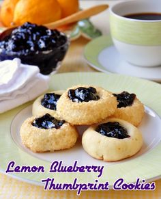 RECIPE # 28 for our Cookie Month is Lemon Blueberry Thumbprint Cookies - very pretty little lemon cookies filled with blueberry jam. A perfect cookie flavor combination.