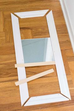 How to make a fake transom over a door or window using trim molding and mirrors