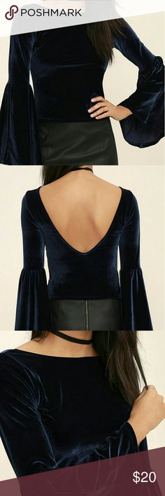 MORE RDUCED NWT Lulu's navy velvet ls crop top NWT, never worn, still in plastic!  Lulu's Look to the Moon navy blue velvet long sleeve crop top.  On-trend, retro bell sleeves.  Sexy v-back balanced by a conservative rounded neckline.  Runs small.  Perfect to pair with a choker for the perfect boho outfit!  Offers welcome.  Bundle to save! Lulu's Tops Crop Tops