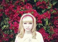 Tavi Gevinson's blunt bangs and blonde hair gives her a unique retro look.