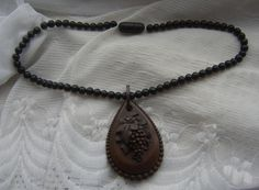Antique Victorian VULCANITE Grapes CAMEO Pendant on Black Wood Bead Necklace