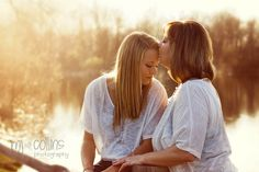 Beautiful photograph of a mother and daughter. The lighting is perfect. I would love to have a photograph like this on the day I wed with this kind of lighting. Perfection!!