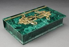 Russian malachite book form box, the hinged lid adorned with ormolu decoration. Circa - 1900.