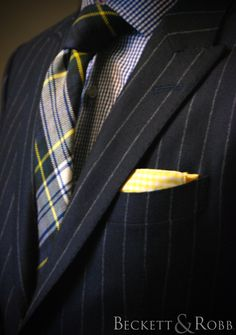 We love this cold weather look.  Navy flannel chalk stripe suit, small navy gingham shirt, yellow gingham cotton pocket square, and a thick Scottish tartan fabric (purchased in a little shop on Regent's Street in London's West End) used to build this necktie.  All by Beckett & Robb.
