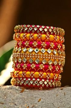 www.theaspirehigh.com Pink-And-Yellow-Colored-Ethnic-Decorated-Single-Hand-Silk-Threaded-Bangle-Set-With-Kundan-Work--Size-2-6--id-3498057.html
