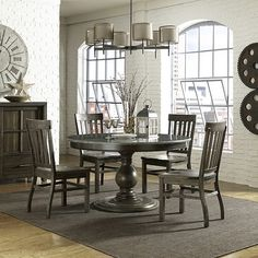 This incarnation of the Karlin dining table features a stunning Bluestone tabletop. The collection features the ultimate versatility in style: swing from a more vintage vibe to a more contemporary simply by mixing and matching the pieces you surround it with. The beauty of natural wood shows through the distressed finish, and again you decide what vibe, from cottage warmth to industrial chic, it brings to your home.    Karlin 5 Piece Bluestone or Wood Table Top Dining Set