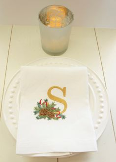 Christmas Stocking Stuffer Idea - Monogrammed and embroidered pine cone and greenery linen towel for kitchen or bath