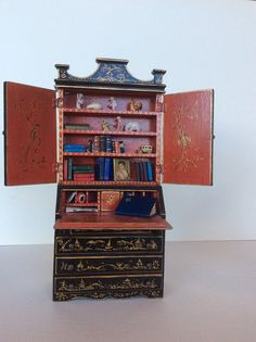 An ebony painted Tynietoy Japanned secretary. Very few pieces of this furniture done by Tynietoy have been found.