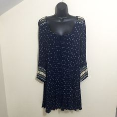 American Eagle boho dress Size small. Stretchy material. No flaws and excellent condition. Only worn once. Main color is navy blue. Long sleeves. Only selling because I need the money. American Eagle Outfitters Dresses Long Sleeve