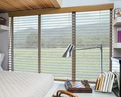 Enjoy classic wood blind styling with sleek cordless control. A look that's always in style, our Cordless Wood Blinds can be precisely raised, lowered and positioned without visible lift cords. Shown in Honey/Oak 4484.