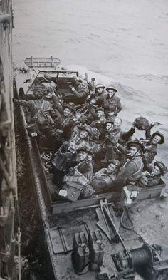 British troops being taken ashore in a DUCK during the DDay landings. I would say from the cap badge on the Sergeant they are men of the Royal Engineers.