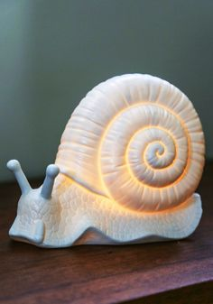 Come Snail Away Lamp. Journey off to dreamland with this bright white snail from Streamline as your guide! #white #modcloth
