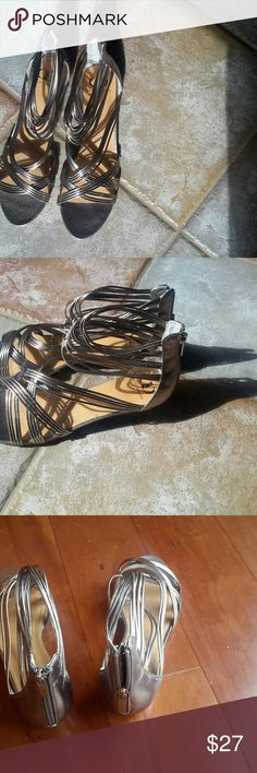 NIB Kelsi Dagger Pewter Sandals, Size 10 New in box, Kelsi Dagger Pewter Sandals, Size 10. These sandals feature a back zipper to easily slide your foot into the shoe. The shoes are a pewter/silver color. On trend, semi-gladiator.  Manmade material. Kelsi Dagger Shoes Sandals