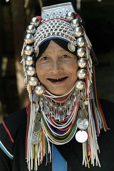 Thailand Hill Tribes. The women wear beautiful headdresses made of beads, cloth, wood, and pewter or sometimes silver gotten from old coins.