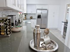 The transformed kitchen is guest-ready with modern gray countertops and a complete cocktail set, as seen on HGTV's Brother Vs Brother.