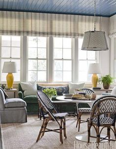 Cozy eating area with French bistro chairs, Saarinen table and painted glossy blue ceiling