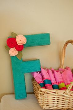 Yarn wrapped letter with felt flower decorations photographed by Karen Feder Photography
