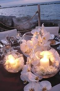 centerpieces with candles and dahlias | Lovely seashell beach centerpieces! :)