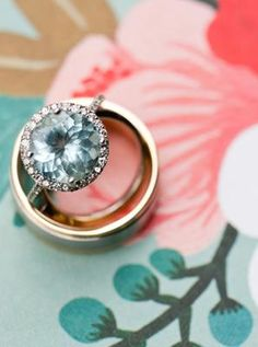 Beautiful engagement ring (aquamarine?)... Pinned because it looks similar to my engagement ring (which is an aquamarine) and it's a beautiful pic to have taken.