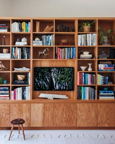 While the lower cabinets hide their son's toys and other unsightly clutter, the shelves artfully display the family's collection of books, trinkets, and of course, their television. unit With Book Shelf Inside an LA Midcentury Mod Makeover Home Library Design, Family Room Design, House Design, Tv Unit Interior Design, Family Rooms, Plywood Walls, Plywood Shelves, Plywood Cabinets, Plywood Furniture