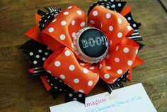 Bottle-cap bow.  Get inspired, DIY and save. Get your bottle cap craft supplies at www.fizzypops.com.
