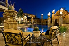Incredible fire-&-water pool with hidden grotto, Utah - pic 2 of 5 - columns are capped with fire urns for a sense of drama