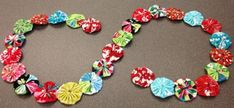 Make a merry and bright garland for your mantel or tree by sewing easy fabric yo-yos together.