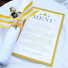 Yellow menu cards and stripped ribon napkin ties popped against ikat linens.