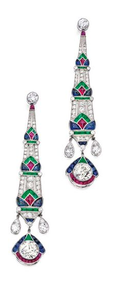 Pair of Platinum, Diamond and Colored Stone Earrings The Art Deco-style earrings suspending two old European-cut diamonds weighing approximately 4.75 carats, further set with numerous round, old European and single-cut diamonds weighing approximately 2.25 carats, decorated with buff-top rubies, sapphires and emeralds