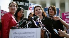 Lori Windham (C), senior counsel for The Becket Fund for Religious Liberty,addresses the news media in front of the Supreme Court after the ...