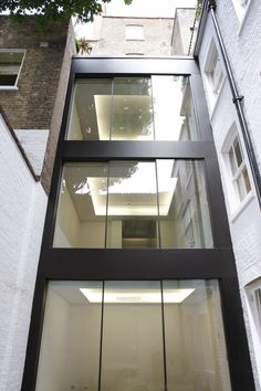 Sliding glass doors were installed on each floor of the multi storey extension with glass balustrades used on upper floors to create Juliette Balconies