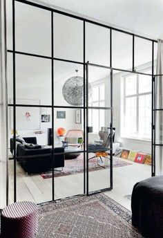 Glass room dividers / elle decoration UK -- This room divider creates definition without obstructing views and light - an important consideration if you have a small, dimly lit space. Elle Decor, Home Deco, Home Living Room, Living Spaces, Small Living, Door Design, House Design, Wall Design, Glass Room Divider