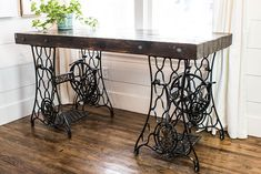 A rustic industrial desk made from two vintage sewing machine treadle bases. An easy DIY if you can find matching bases! Perfect for a farmhouse style home office. Table, Furniture Diy, Retro Furniture, Old Sewing Machine Table, Rustic Diy, Diy Desk, Diy Furniture, Sewing Desk