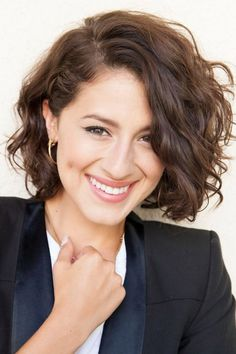 Light and fluffy short haircut for women with a natural wavy hairs.