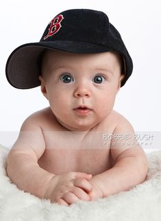 picture of a 3 month baby boy in a baseball cap at Bobbie Bush Photography