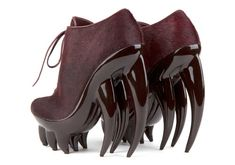 Iris van Herpen has always pushed the limited of fashion. She recently collaborated with United Nude on a wedge shoe made of fiberglass and carbon fiber shaped like fangs for her Spring/Summer 2012 collection.