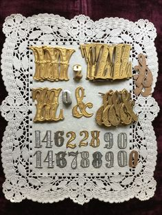 Antique cardboard dresden letters and numbers