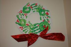 Random Handprints - A NYC Mom Blog... live from New Jersey: 'Tis the Season for... Handprint Christmas Wreaths; I used green paper and did the hand prints directly on the paper.  I also used the red paint to make the bows.