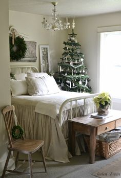A Christmas tree in the bedroom & a wreath over the bed has to be one of the coziest things <3