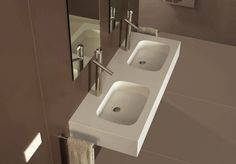 bathroom -- love this sink and faucets! from Silestone